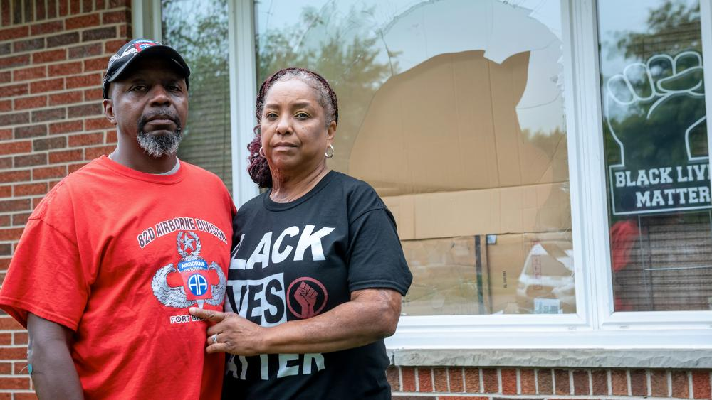 Eddie Hall Jr. and his wife Candace stand in front of their Warren, Mich., home, on Thursday, Sept. 10, 2020 (David Guralnick/Detroit News via AP)