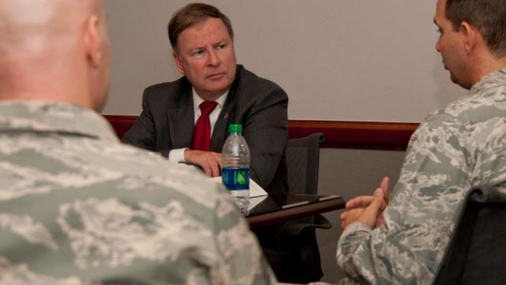 US Rep. Doug Lamborn (R-COLO) listens to the concerns of two airmen during a visit to Peterson Air Force Base . Image courtesy: Peterson Air Force Base.