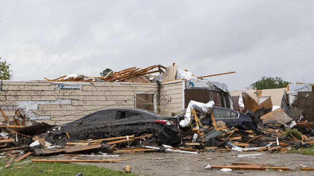 A home had its roof torn off after a tornado ripped through Monroe, La. just before noon on Sunday, April 12, 2020 (Nicolas Galindo/The News-Star via AP)