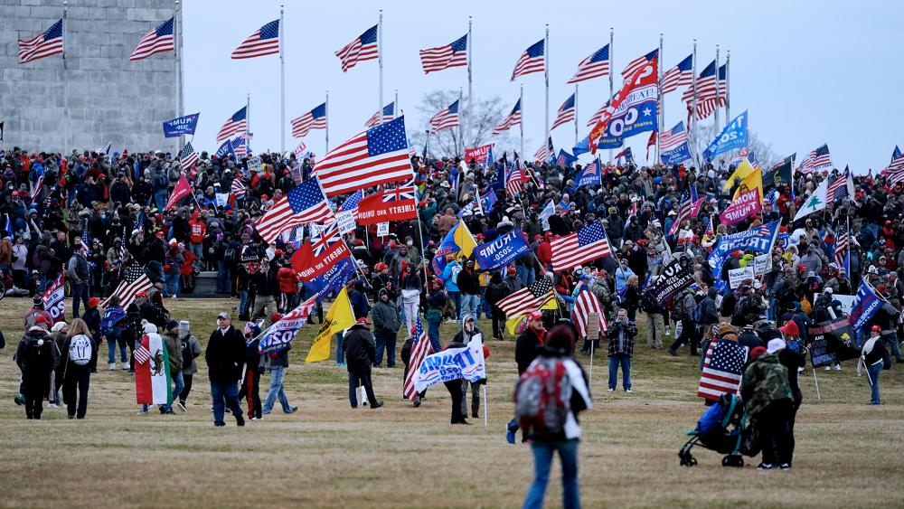 Trump supporters gather on the Washington Monument grounds in advance of a rally Wednesday, Jan. 6, in Washington. (AP Photo/Julio Cortez)