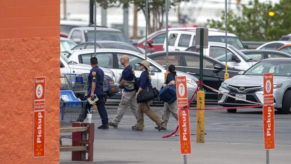 FBI agents arrive at the Walmart store in the aftermath of a mass shooting in El Paso, Texas, Sunday, Aug. 4, 2019 (AP Photo/Andres Leighton)