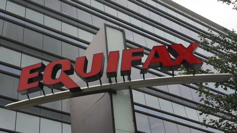 This July 21, 2012, file photo shows signage at the corporate headquarters of Equifax Inc. in Atlanta (AP Photo/Mike Stewart, File)