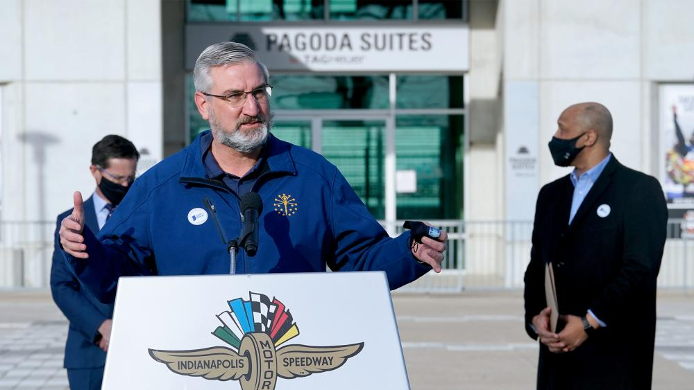Indiana Gov. Eric Holcomb speaks at the Indianapolis Motor Speedway, Friday, March 5, 2021, in Indianapolis. (AP Photo/Darron Cummings)
