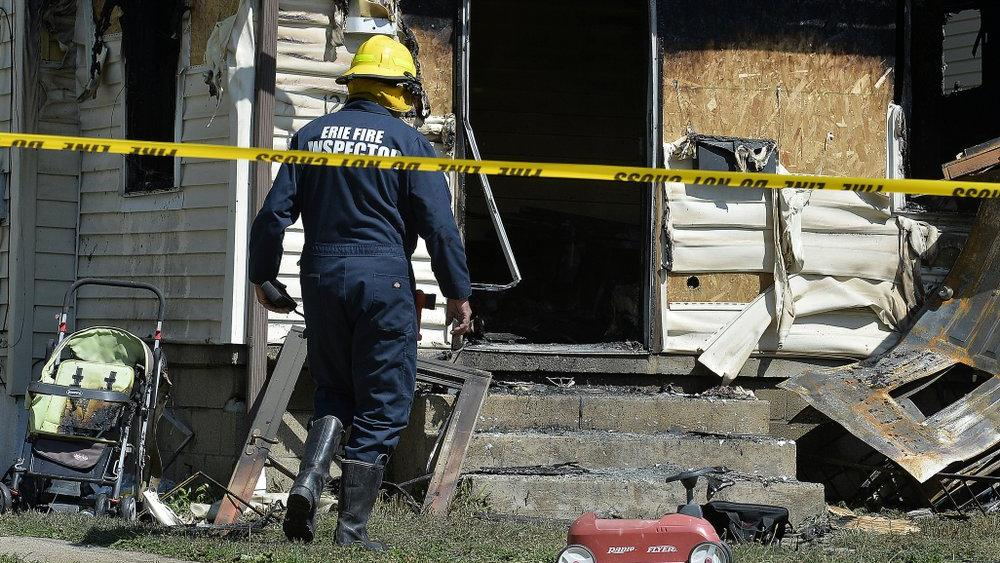 Erie Bureau of Fire Inspector investigates a fatal fire at 1248 West 11th St. in Erie, Pa, on Sunday, Aug. 11, 2019 (Greg Wohlford/Erie Times-News via AP)
