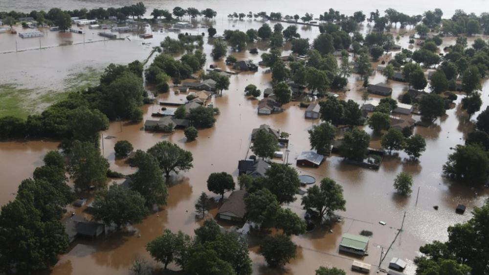 Homes are flooded on the Arkansas River in Tulsa, Okla., on Friday, May 24, 2019. The threat of potentially devastating flooding continued Friday along the Arkansas River from Tulsa into western Arkansas. (Tom Gilbert/Tulsa World via AP)