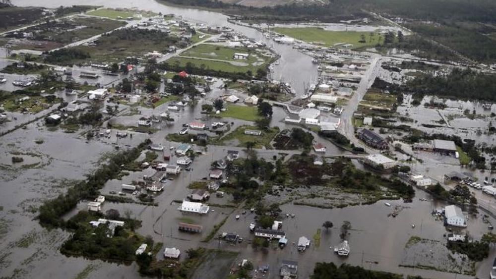 Flood waters from Hurricane Florence inundate the town of Engelhard, North Carolina on Saturday. AP Photo.