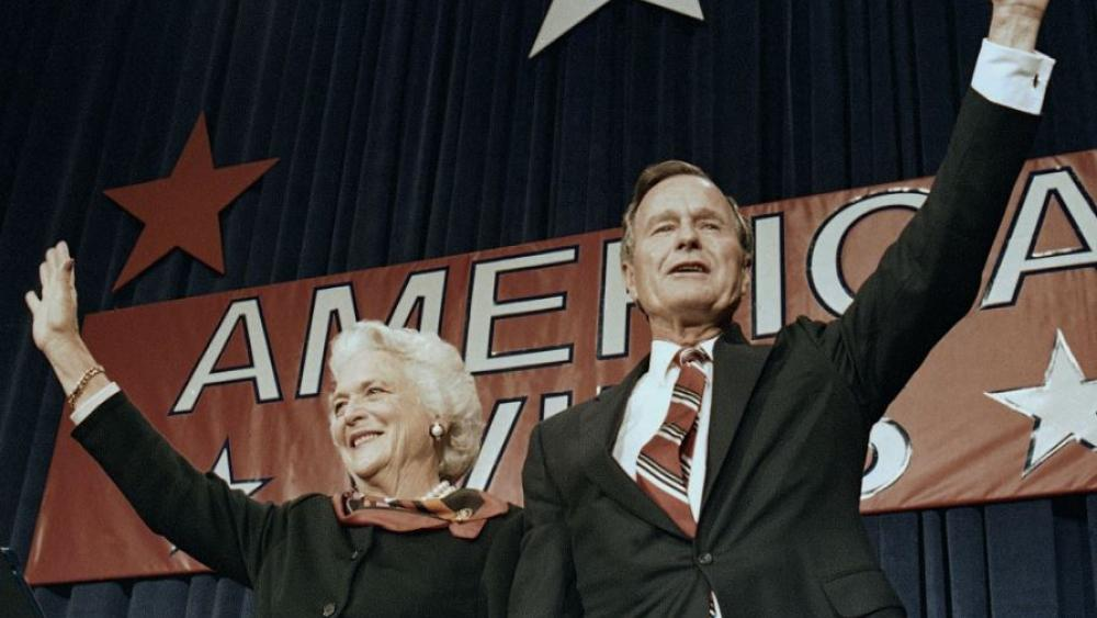 In this Nov. 8, 1988 file photo, President-elect George H.W. Bush and his wife Barbara wave to supporters in Houston, Texas after winning the presidential election. AP Photo.