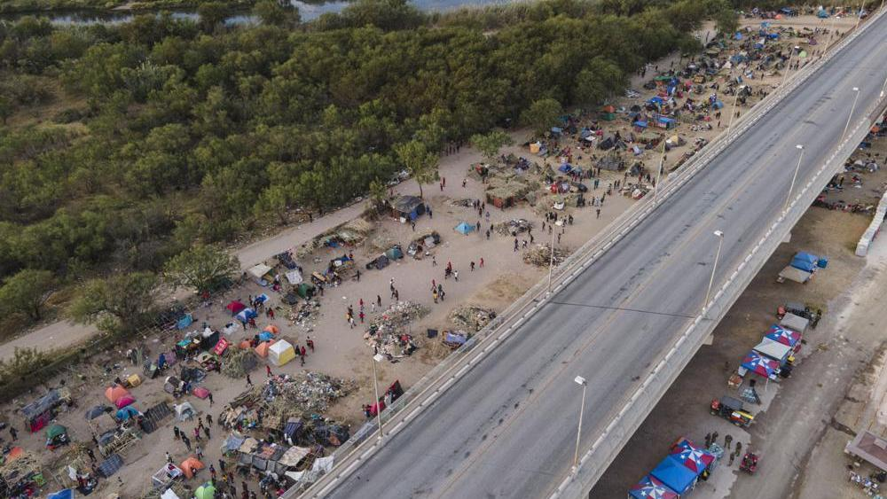 Migrants, many from Haiti, are seen at an encampment along the Del Rio International Bridge, Wednesday, Sept. 22, 2021, in Del Rio, Texas. (AP Photo/Julio Cortez)