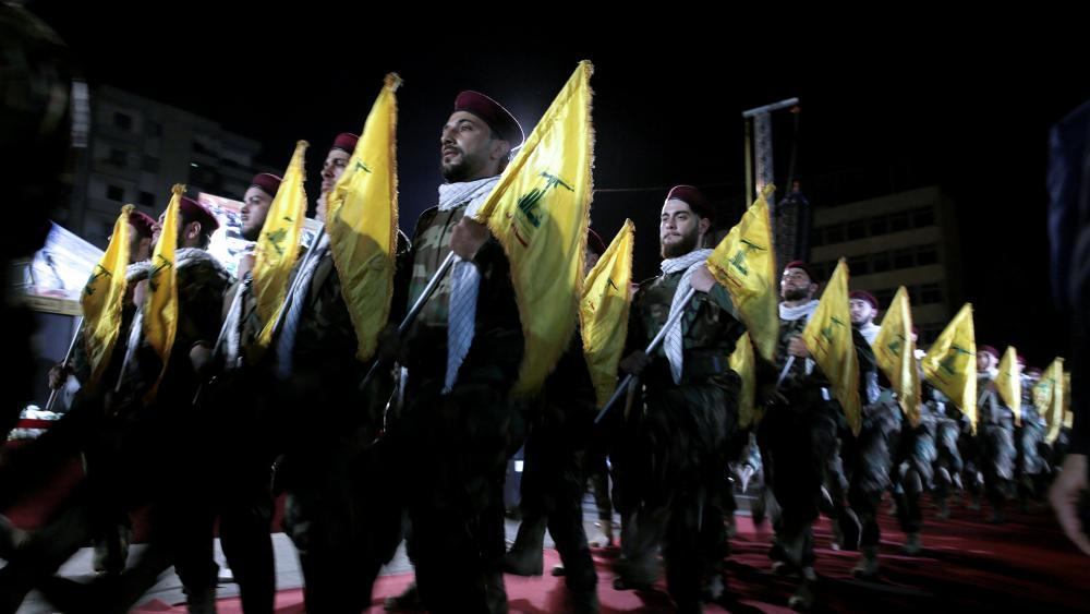 In this May 31, 2019 file photo, Hezbollah fighters march at a rally to mark Jerusalem day or Al-Quds day, in the southern Beirut suburb of Dahiyeh, Lebanon.(AP Photo/Hassan Ammar, File)