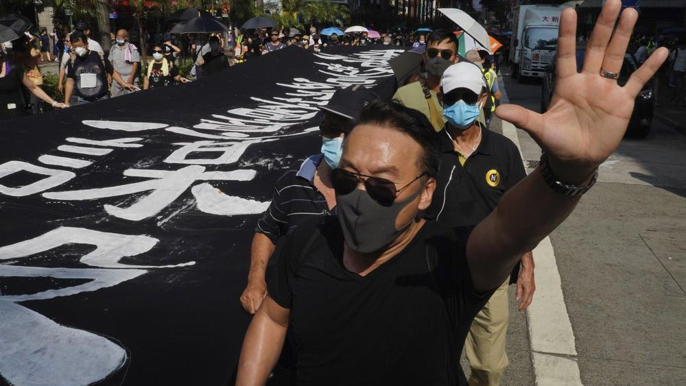 All subway and trains services are closed in Hong Kong after another night of rampaging violence that a new ban on face masks failed to quell (AP Photo/Vincent Yu)