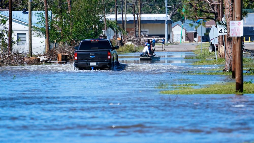 A truck drive through floodwaters in a neighborhood in Lake Charles, La., Saturday, Oct. 10, 2020, after Hurricane Delta moved through on Friday. (AP Photo/Gerald Herbert)