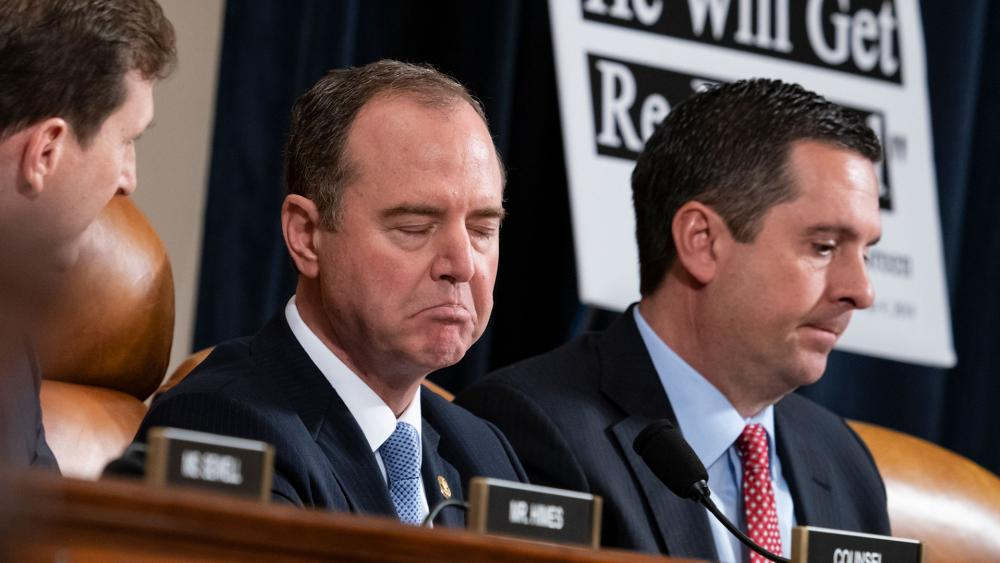 House Intelligence Committee Chairman Adam Schiff, D-Calif., left, responds to Rep. Devin Nunes, R-Calif, the ranking member, right, as the panel holds the first public impeachment hearings of President Trump (AP photo)