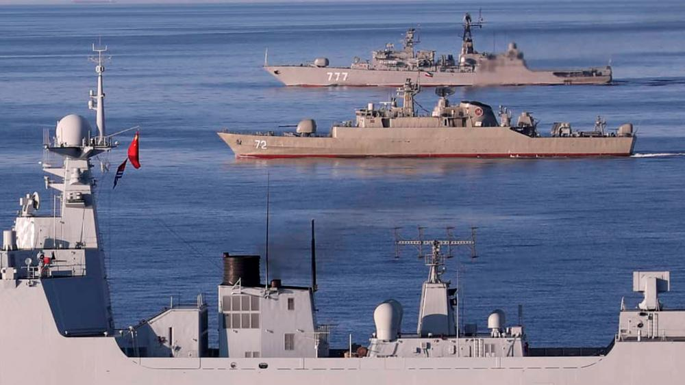 In this photo provided Saturday, Dec. 28, 2019, by the Iranian Army, warships sail in the Sea of Oman during the second day of joint Iran (Iranian Army via AP)