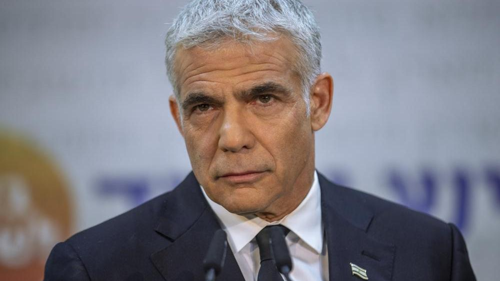 Israeli opposition leader Yair Lapid listens during a news conference in Tel Aviv, Israel. (AP Photo/Oded Balilty, File)