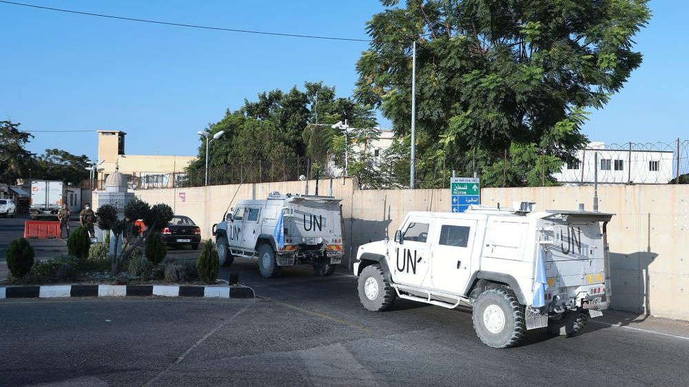 U.N. peacekeeping military vehicles enter the headquarters of the U.N. peacekeeping force in the southern Lebanese border town of Naqoura, Lebanon, Wednesday, Oct. 14, 2020. (AP Photo/Bilal Hussein)