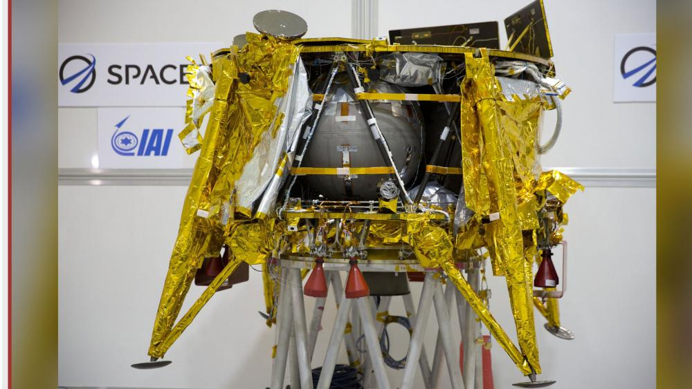 """The SpaceIL lunar module, an unmanned spacecraft, is on display in a special """"clean room"""" where the space craft is being developed, during a press tour of their facility near Tel Aviv, Israel. AP photo."""