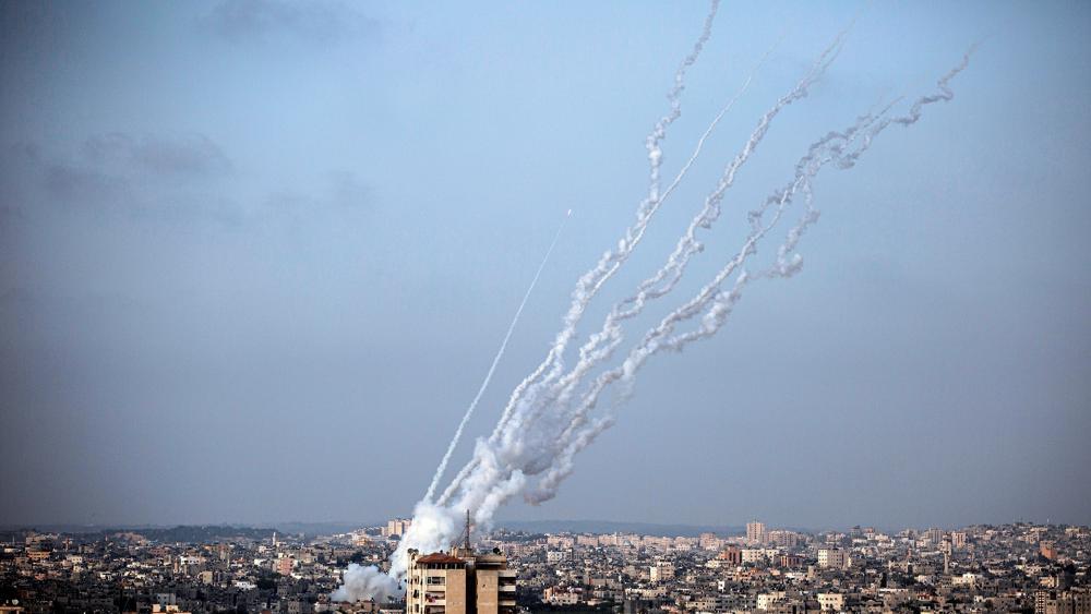 Terrorists launch rockets from the Gaza Strip towards Israel, Monday, May. 10, 2021. (AP Photo/Khalil Hamra)