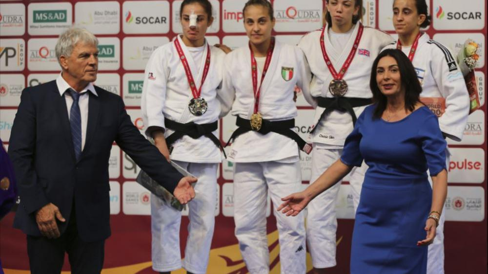 Israeli Culture and Sport Minister Miri Regev, right bottom, and Israel Judo Association President Moshe Ponte, during the women 52 kg medal ceremony at the Abu Dhabi Grand Slam Judo tournament in Abu Dhabi, United Arab Emirates on Oct. 27. AP Photo.