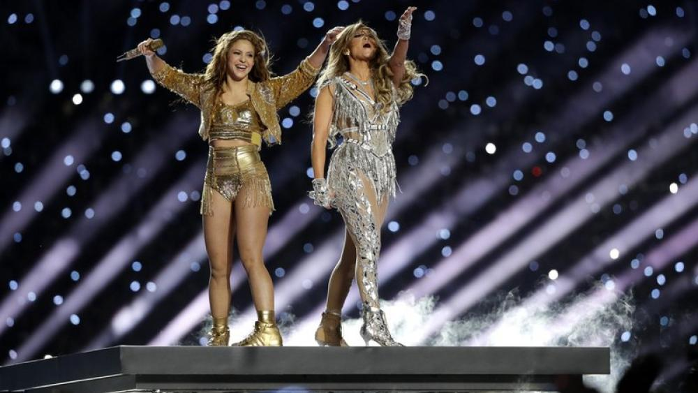 Shakira and Jennifer Lopez perform during halftime of the NFL Super Bowl 54 football game (AP Photo/Seth Wenig)
