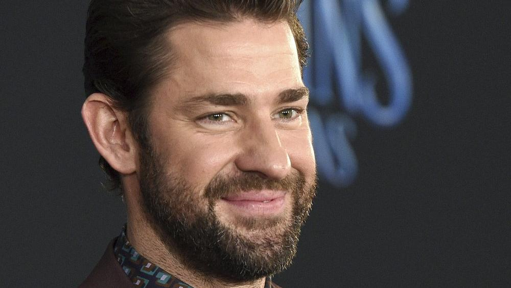"""In this Nov. 29, 2018 file photo, actor-writer-director John Krasinski poses at the premiere of the film """"Mary Poppins Returns."""" (Photo by Chris Pizzello/Invision/AP, File)"""