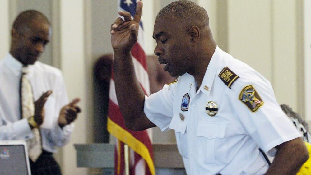In this July 20, 2007 photo, Lowndes County Chief Deputy John Williams speaks during the memorial service for Lowndes County Sheriff Willie Vaughner (Mickey Welsh/Montgomery Advertiser via AP)