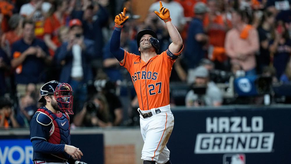 Houston Astros' Jose Altuve celebrates after a home run during the seventh inning in Game 2 of baseball's World Series between the Houston Astros and the Atlanta Braves, Oct. 27, 2021, in Houston. (AP Photo/David J. Phillip)