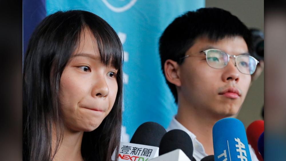 Pro-democracy activists Agnes Chow and Joshua Wong were granted bail August 30, 2019, after being charged with inciting people to join a protest (AP Photo/Kin Cheung)