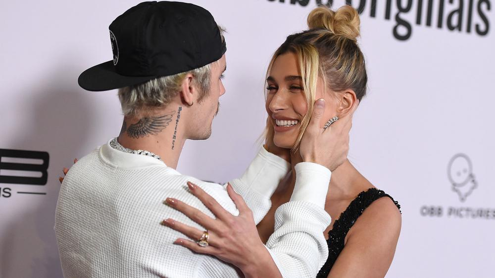"""Justin Bieber and Hailey Bieber arrive at the Los Angeles premiere of """"Justin Bieber: Seasons"""" on Jan. 27, 2020. (Photo by Jordan Strauss/Invision/AP)"""