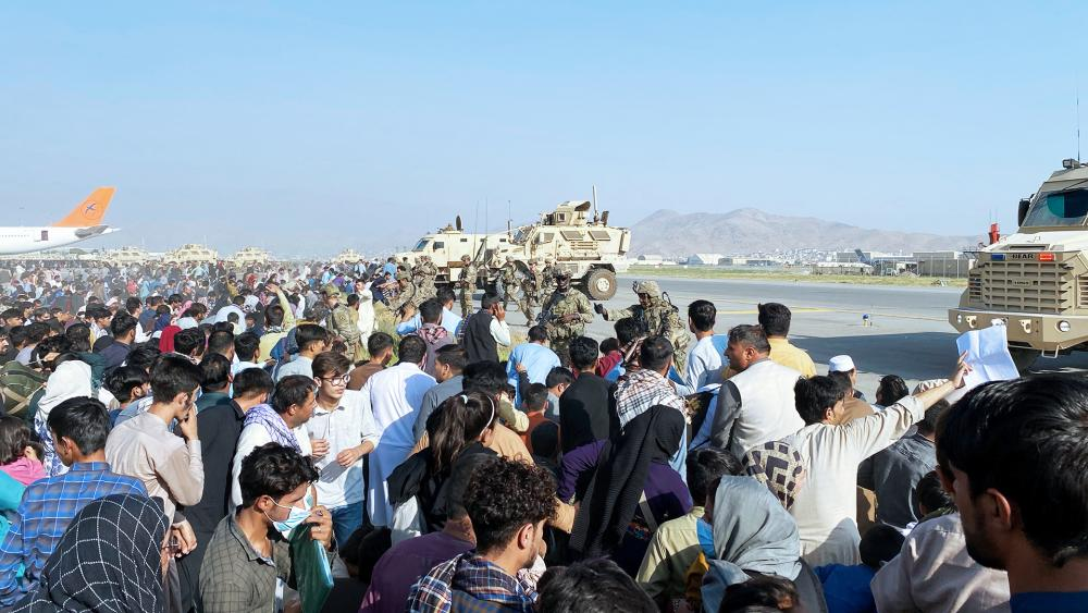 Thousands of Afghans trapped by the sudden Taliban takeover rushed the tarmac in Kabul and clung to U.S. military planes (AP Photo/Shekib Rahmani)