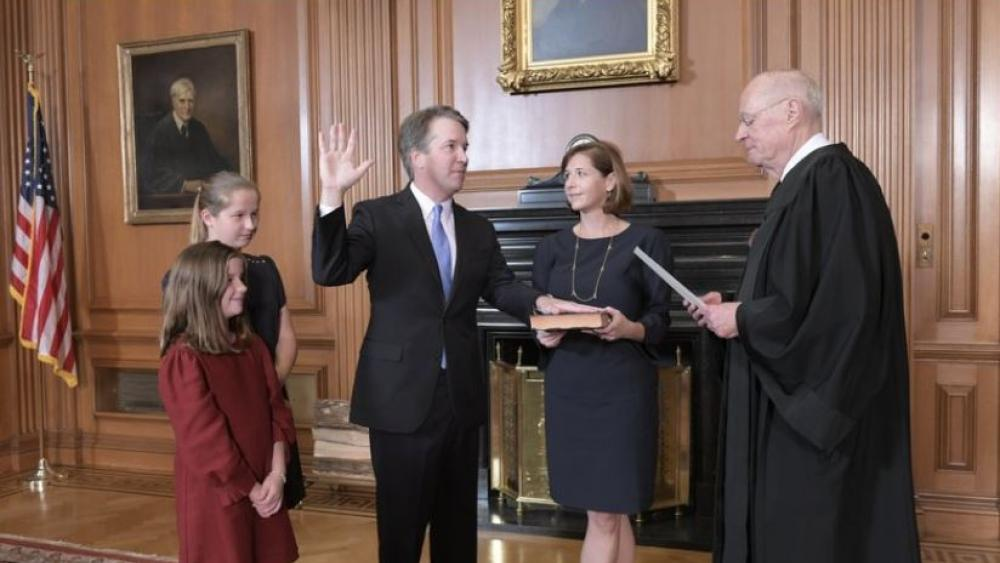 Retired Justice Anthony M. Kennedy, right, administers the Judicial Oath to Judge Brett Kavanaugh in the Justices' Conference Room of the Supreme Court Building. Ashley Kavanaugh holds the Bible. AP Photo.