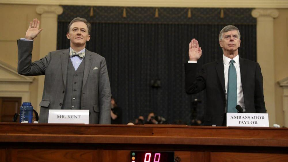 Career Foreign Service officer George Kent and top U.S. diplomat in Ukraine William Taylor, right, are sworn in to testify during the first public impeachment hearing of the House Intelligence Committee on Capitol Hill, Wednesday in Washington. (AP Photo)
