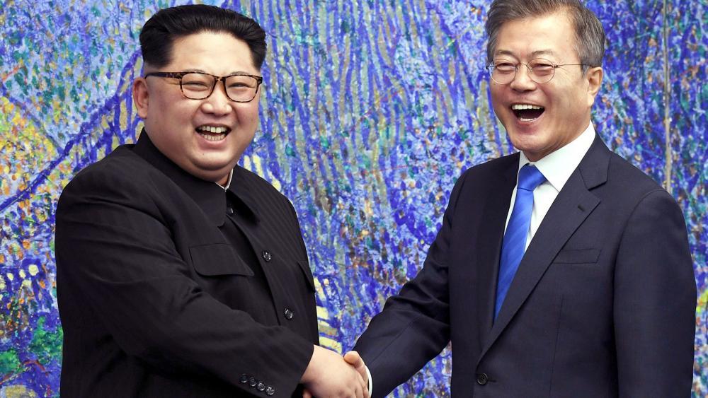 North Korean leader Kim Jong Un Shakes Hands with South Korean President Moon Jae-in, Photo, AP