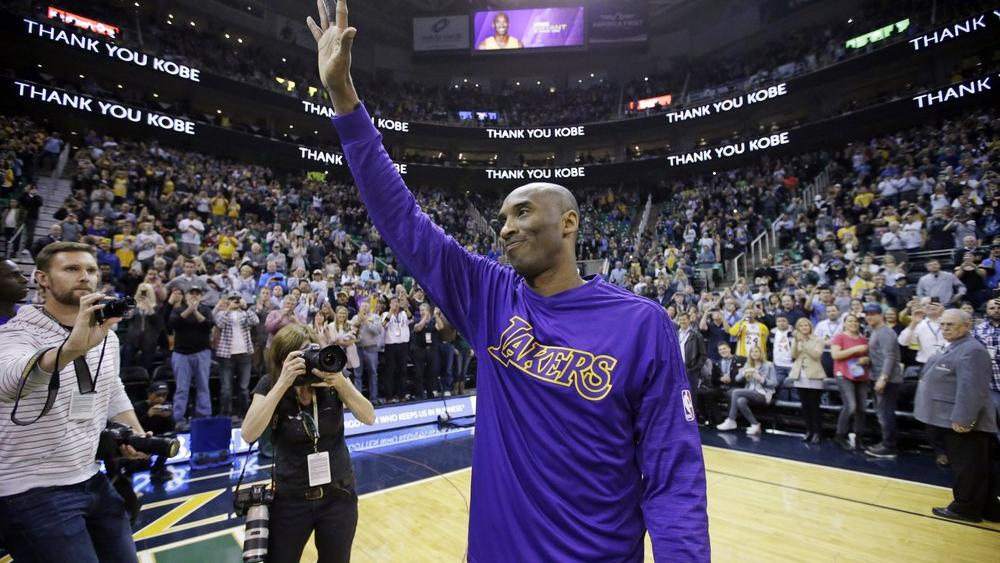 In this March 28, 2016, file photo, Kobe Bryant waves to the fans after his introduction before the start of the first quarter of an NBA basketball game against the Utah Jazz, in Salt Lake City. (AP Photo/Rick Bowmer, File)