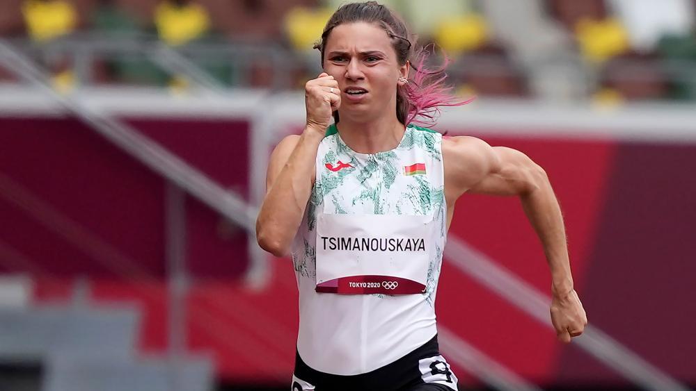 Krystsina Tsimanouskaya, of Belarus, runs in the women's 100-meter run at the 2020 Summer Olympics, Japan. (AP Photo/Martin Meissner)