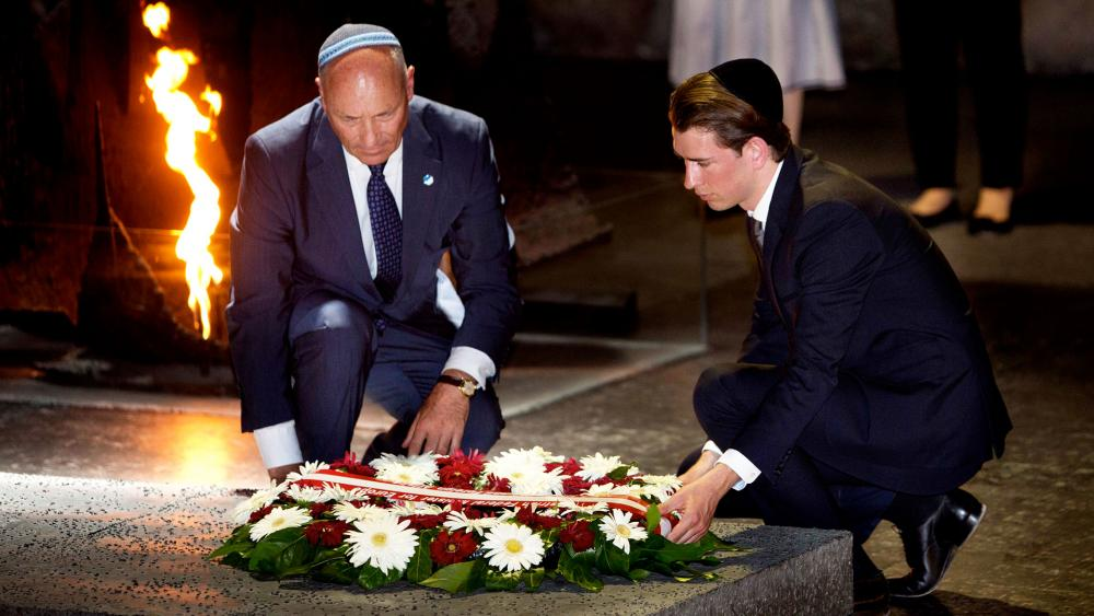 Austrian Chancellor Sebastian Kurz, right, and Austrian Ambassador to Israel Martin Weiss lay a wreath at Yad VaShem Holocaust Memorial, Photo, AP