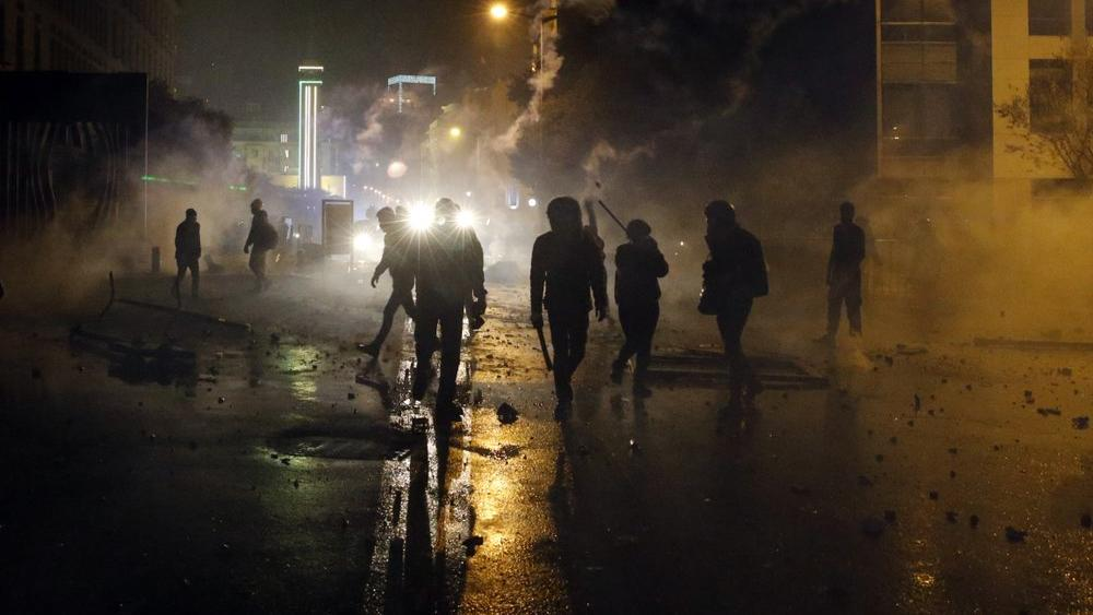 Anti-government demonstrators clash with riot police during a protest in Beirut, Lebanon, Saturday, Jan. 18, 2020. (AP Photo/Bilal Hussein)