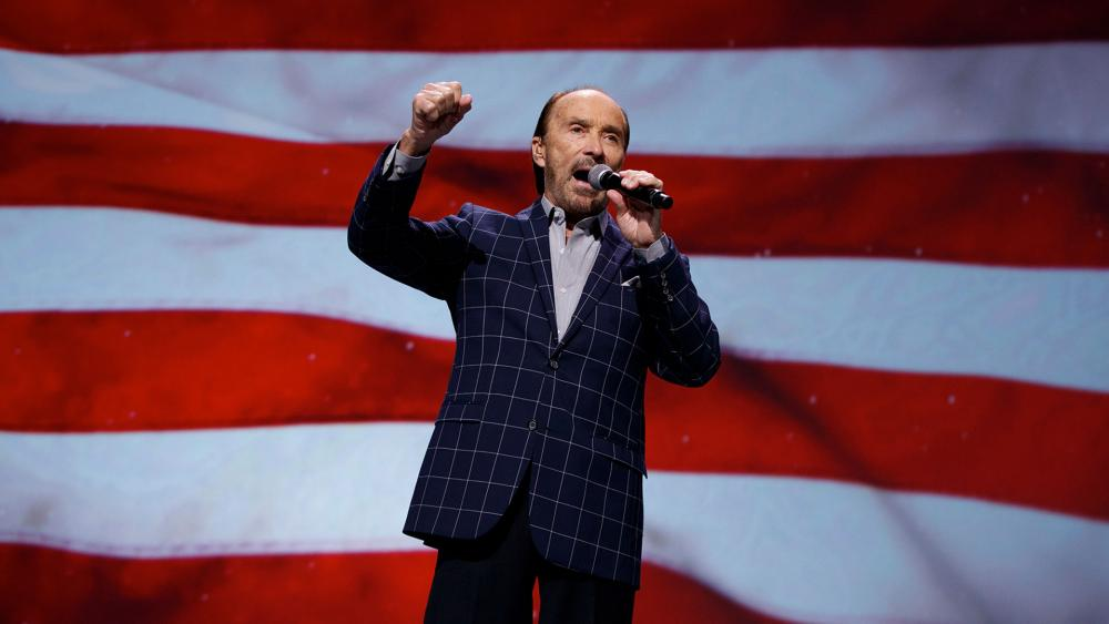 """Singer Lee Greenwood performs """"God Bless the USA"""". (AP Photo/Evan Vucci)"""