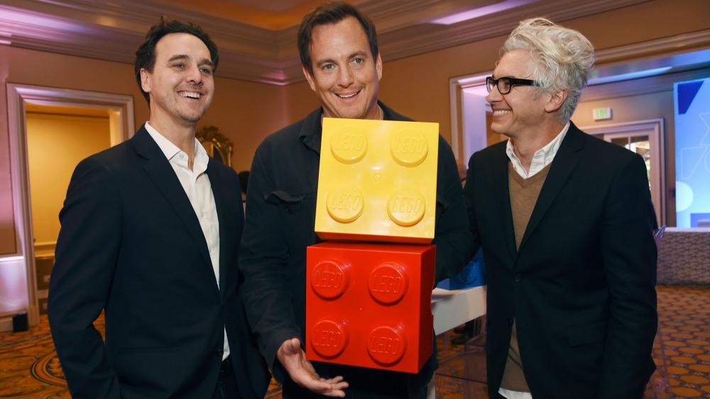 """Will Arnett, center, host of the Fox television series """"Lego Masters,"""" poses with executive producer/showrunner Andrew Dominici, right, and Fox president of alternative programming Rob Wade (AP Photo/Chris Pizzello)"""