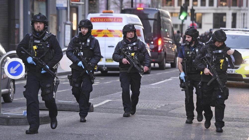 Police on Cannon Street in London near the scene of an incident on London Bridge in central London following a police incident, Friday, Nov. 29, 2019. (AP Photo)