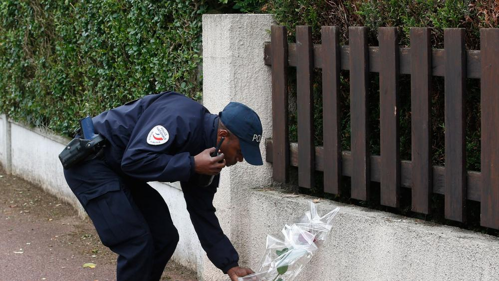 French policeman pays tribute to slain colleagues, Associated Press photo
