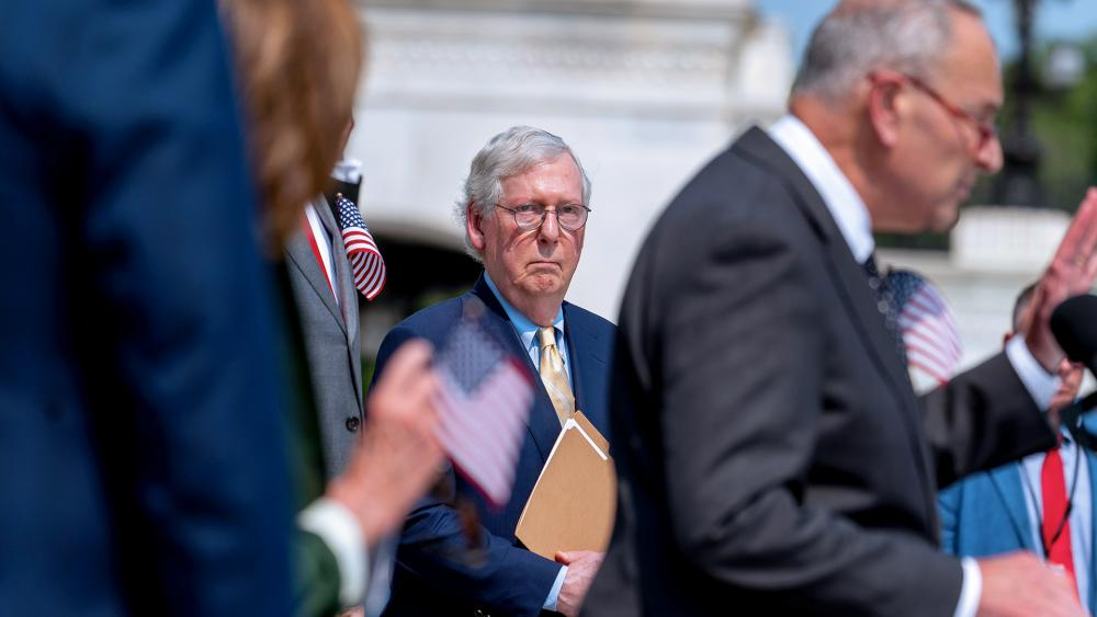 Senate Minority Leader Mitch McConnell looks on as Senate Majority Leader Chuck Schumer speaks (AP Photo/Andrew Harnik)