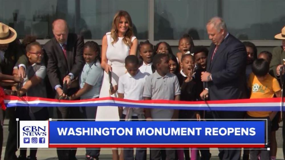 First Lady Melania Trump joined by a group of fourth-graders cut the ceremonial ribbon reopening the Washington Monument on Sept. 19, 2019. (Image credit: CBN News)