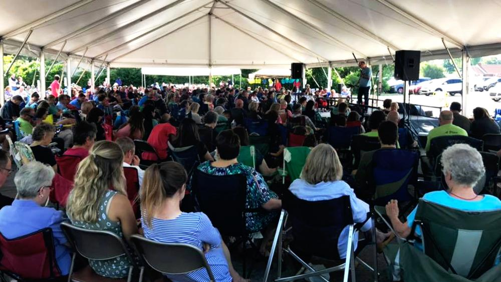 After their church building burned, the Memorial Drive Church of Christ met for services last Sunday under a tent to worship God in their parking lot. (Image credit: Memorial Drive Church of Christ/Facebook)
