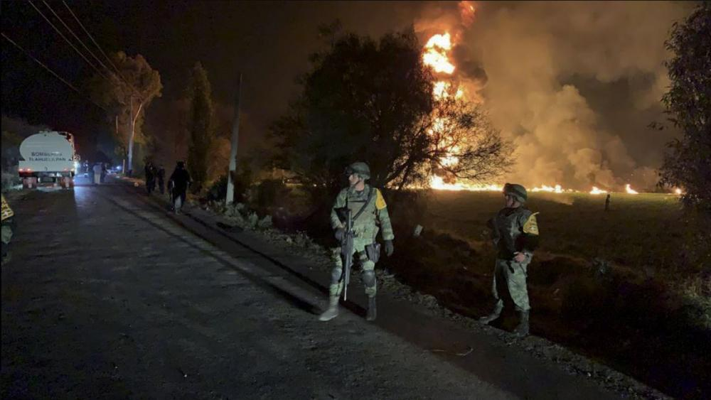In this image provided by the Secretary of National Defense, soldiers guard in the area near an oil pipeline explosion in Tlahuelilpan, Hidalgo state, Mexico, Friday, Jan. 18, 2019. (Secretary of National Defense via AP)