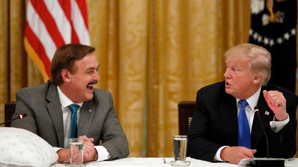 "Michael Lindell, with My Pillow, laughs with President Donald Trump during a ""Made in America,"" roundtable event in the East Room of the White House in Washington, July 19, 2017. (AP Photo/Alex Brandon)"