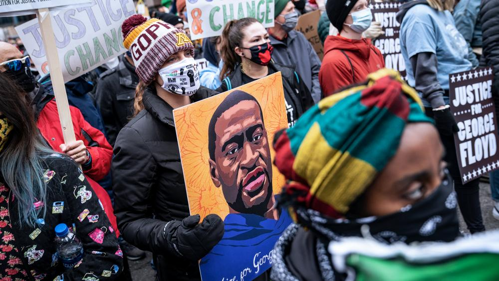 Demonstrators rally outside the Hennepin County Government Center during the murder trial against former Minneapolis police Officer Derek Chauvin in the killing of George Floyd (AP Photo/John Minchillo)