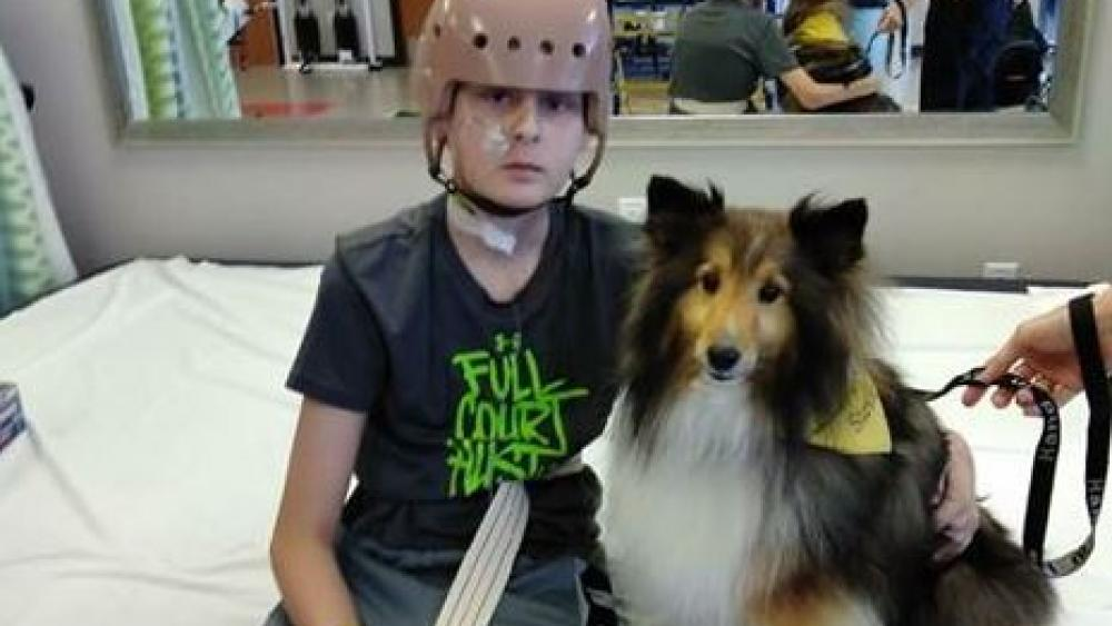 Trenton and Stevie the service dog. Image courtesy: Jennifer Nicole Reindl/Facebook.