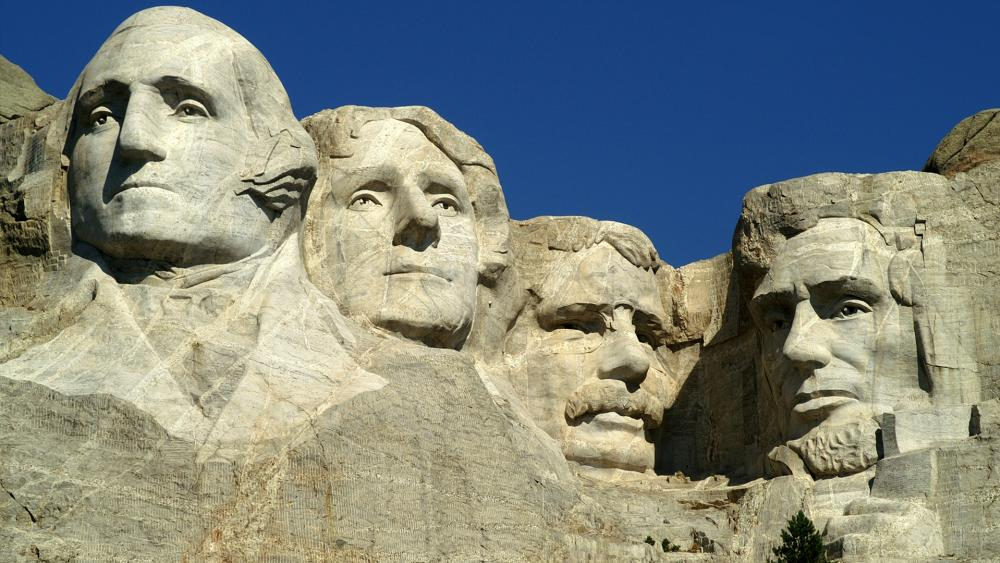 The Mt. Rushmore monument in South Dakota features George Washington, Thomas Jefferson, Abraham Lincoln, and Theodore Roosevelt.