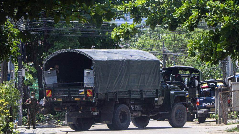A police vehicle is parked at a road in South Okkalapa township to block anti-coup protesters' gathering in Yangon, Myanmar (AP Photo)