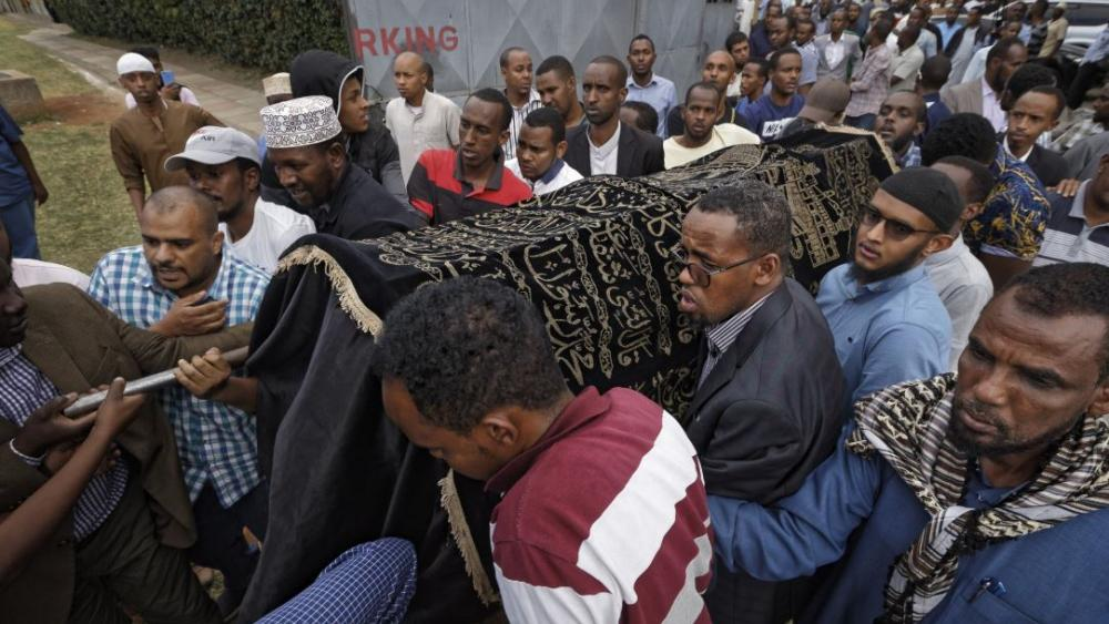 Mourners carry the body of Feisal Ahmed, who was killed with his colleague Abdalla Dahir in Tuesday's attack, as they leave a mosque and head to the funerals in Nairobi, Kenya Wednesday, Jan. 16, 2019. (AP Photo/Ben Curtis)